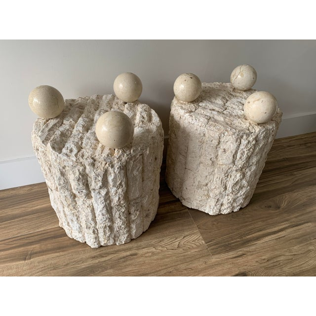 Organic, post modern style pair of Mactan stone side tables. Consisting of textured stone wrapped around a cylindrical...