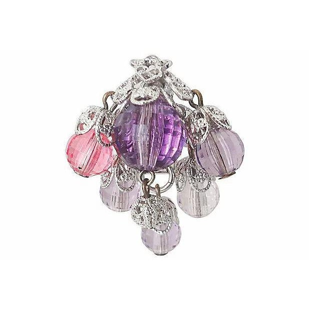 Filigreed silvertone faceted dark & light purple and pink Lucite bead earrings. Clip backs. Circa 1960. Marked: Napier....