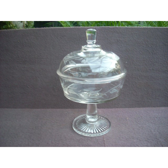 Pressed glass flat bottom compote. Starburst foot bowl and lid are engraved with a delicate feathery fern, leaf and...