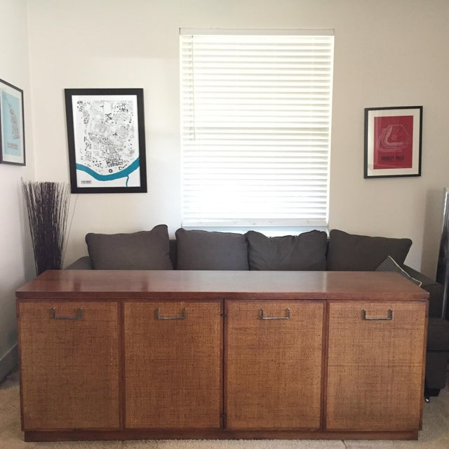Large Mid Century Modern Buffer Server. Featuring woven Cane fronts with silver pulls and a dark walnut finish. This thing...