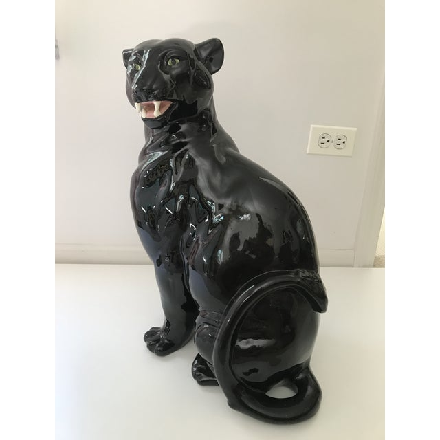 Large black panther statue with a unique regal stance in very good vintage condition.