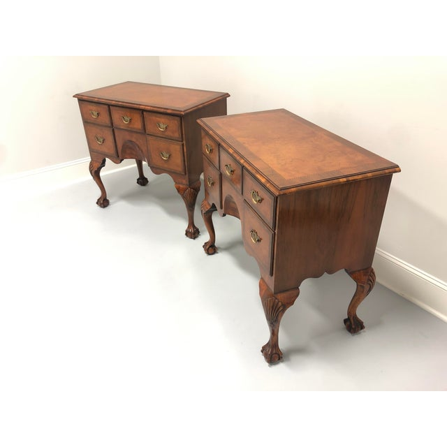 A fine pair of inlaid burl Walnut lowboys. Originating in England in the 20th Century. Chippendale style. Cabriole legs...