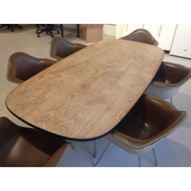 Bargain now. Eames conference table with six bucket chairs. Veneer top in walnut with nice patina. Chairs are naugahyde...