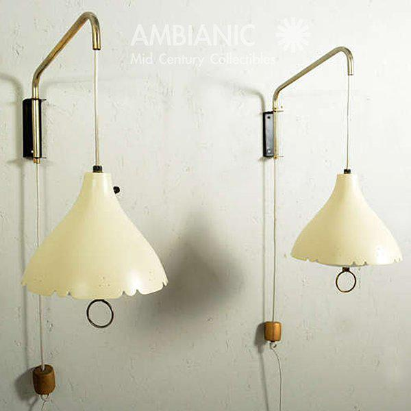 For your consideration a pair of Mid-Century period wall sconces. Aluminum shade with sculptural shape and diffuser....