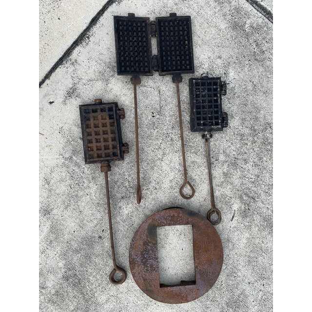 Antique waffle iron made of cast iron. With long handles. Probably German made for open fire or on the coal oven. Fitting...