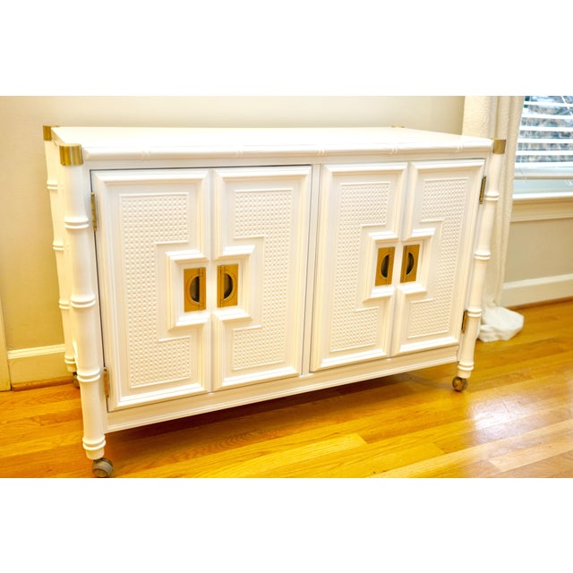 This is the cutest piece. I love love love the brass caps, textures, and lines on it. Newly lacquered white. Great...