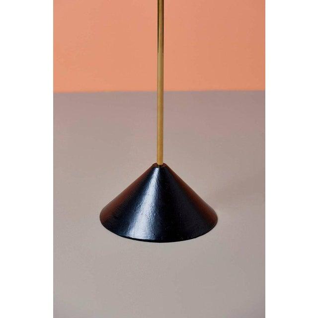 Floor mirror #4959 by Carl Auböck in brass and walnut.