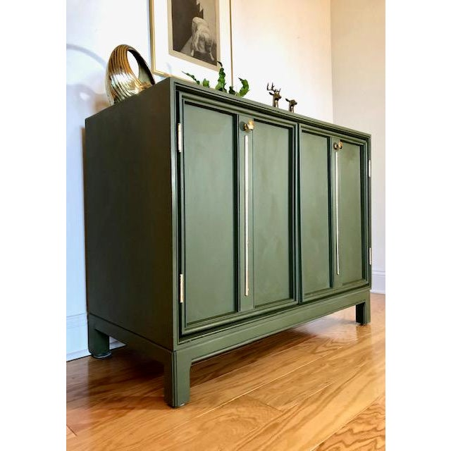 Here is a beautiful bar cabinet or console that has been hand painted in Annie Sloan's 'Olive' and hand waxed for...
