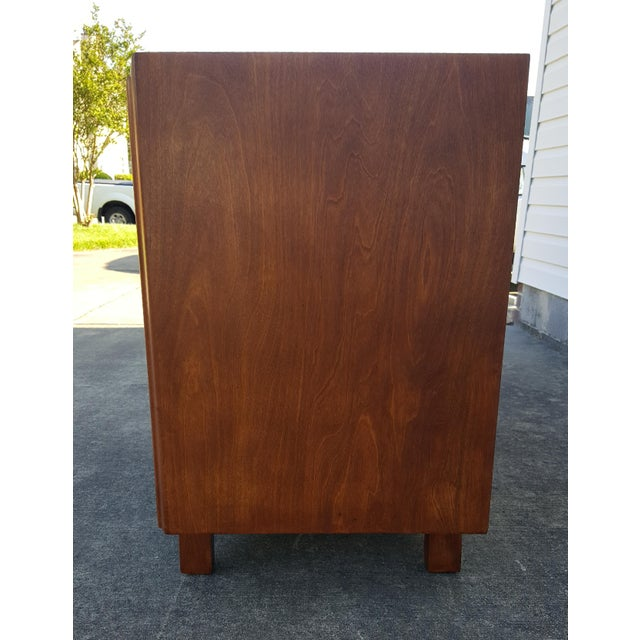 This mid-century modern small dresser, sideboard cabinet, or credenza is designed by Edmond Spence. Exceptionally...