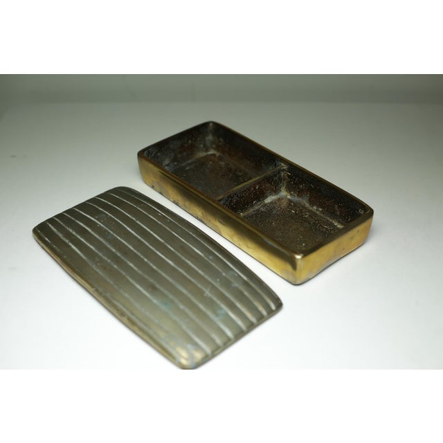 Very heavy bronze ribbed box with two compartments.