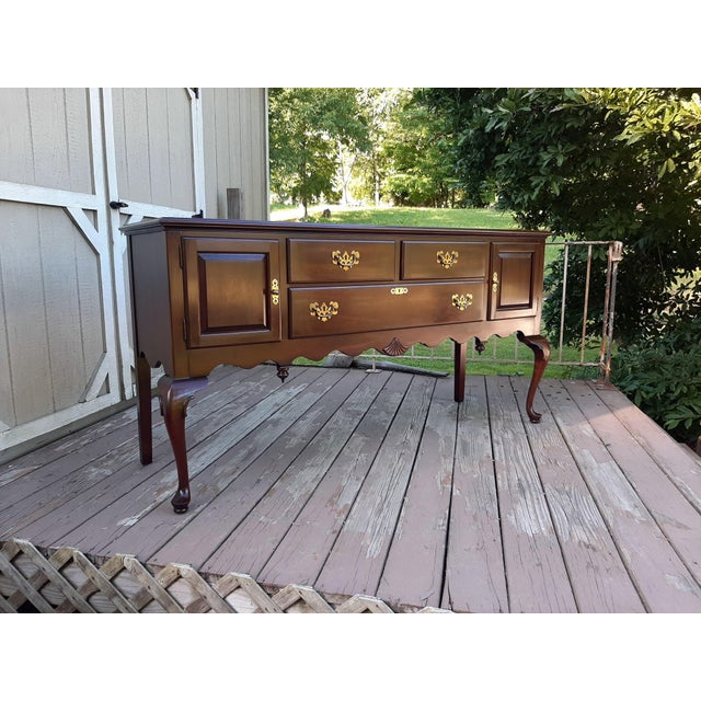 Item offered is a lovely classic vintage Ethan Allen Georgian Court Cherry solid wood Sideboard #11-6207. Georgian Court...