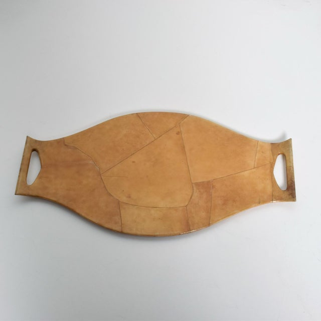 We are pleased to offer for your consideration a beautiful and unique service tray in solid wood wrapped in goatskin....