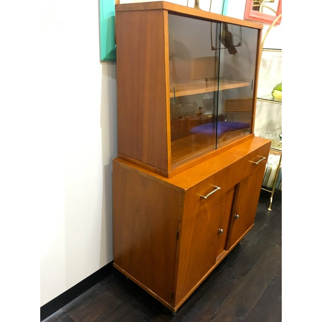 This Craddock Dependable Furniture Mid Century Modern china hutch cabinet can be used in your Dining Room for plates,...