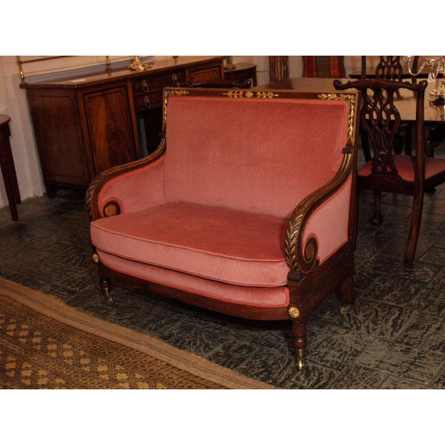 Antique French mahogany Empire style upholstered settee.