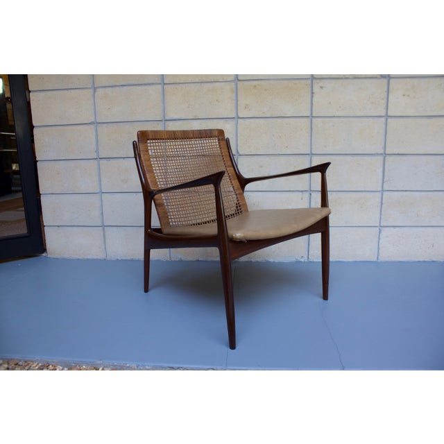 A very rare and early example of famed Danish designer Kofod Larsen's work. Solid teak frame with expertly crafted...