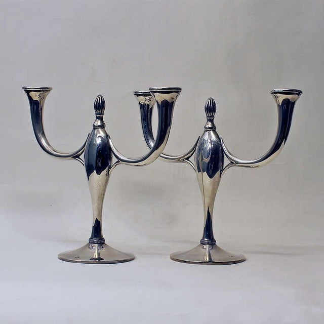 "Pair of Art Deco candelabras, 2 arms, sterling silver, weighted bases. Stamps: ""Star"", 071B and 171B. Stamp ""Star""..."