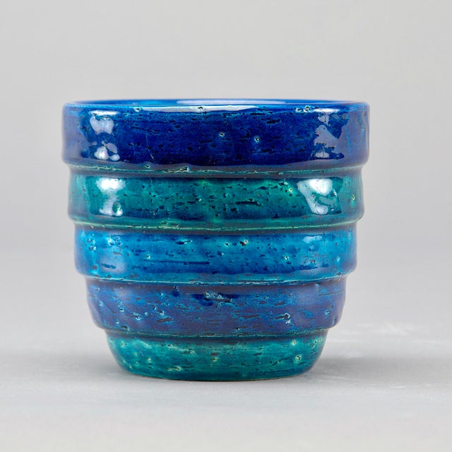 Ridged bands of deep blue, turquoise and green. Blue wash interior. Unmarked, but this piece was designed by Aldo Londi...