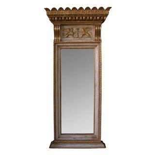 A Regal and Boldly-Scaled Swedish Egyptian Revival Ivory Painted & Parcel-Gilt Pier Mirror For Sale