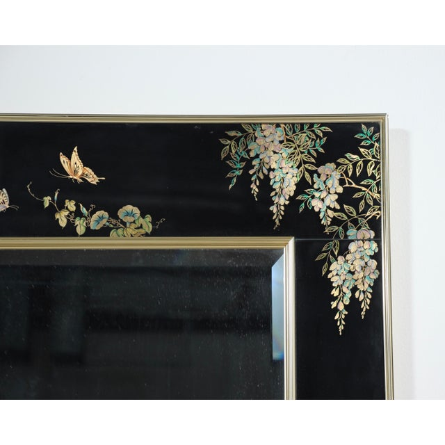 Fabulous, 1980s reverse hand painted glass mirror with a brass plated frame in the Asian Moderne style by LaBarge, USA....