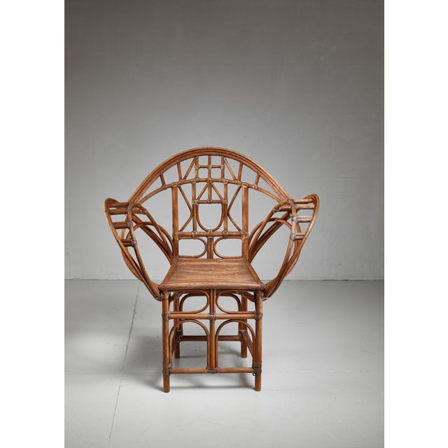 An early 20th century hand-crafted Austrian chair made of curved willow, connected with rawhide strips.