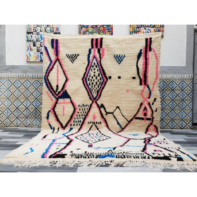 Authentic Azilal Rug from Marrakesh Handmade 100% pure wool. White background with playful asymmetric black, blue, pink...
