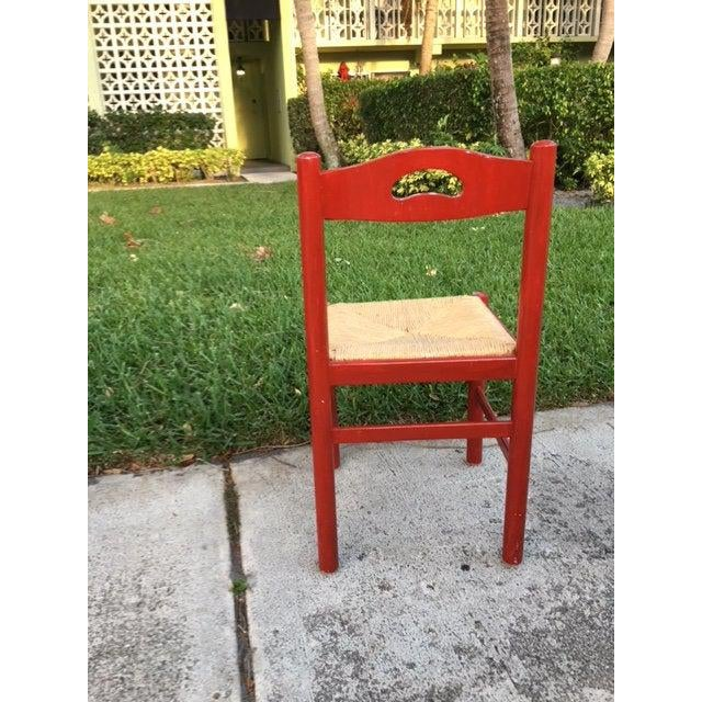 This is a cute red wood chair with a ruched seat. It matches our rattan red pagoda desk in another listing. This can be...