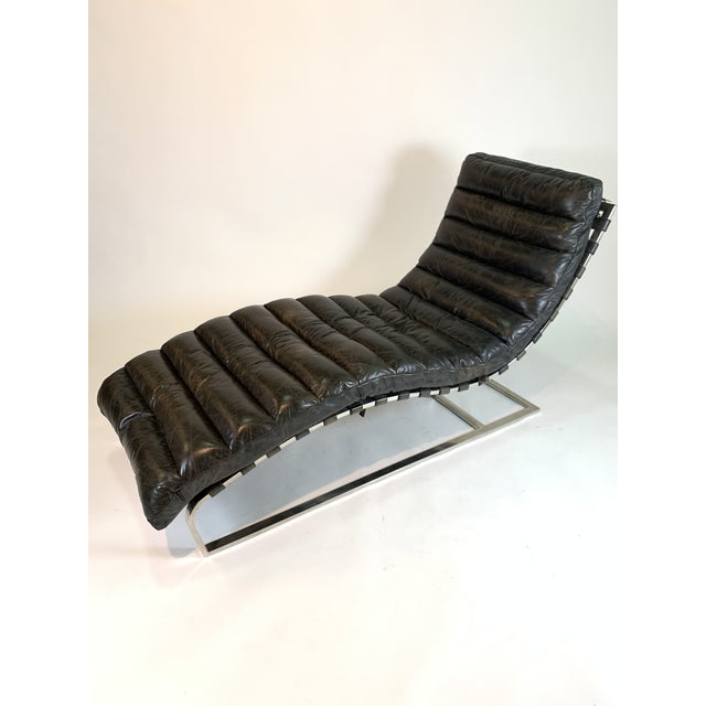 Timothy Oulton designed this chaise for his Restoration Hardware collection. He bridges the gap between classic mid-...