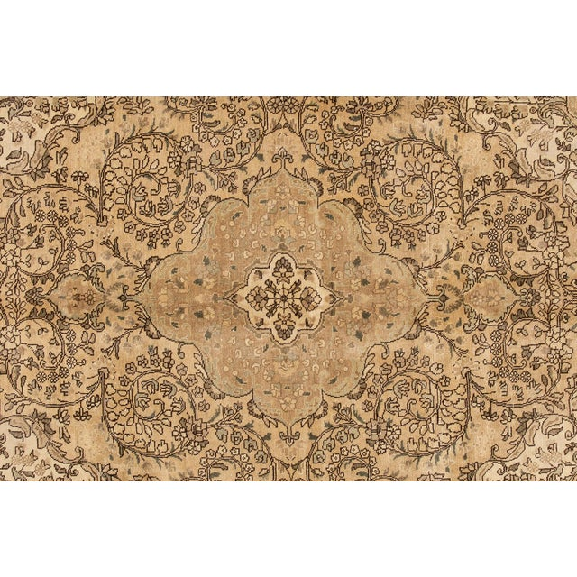 A hand-knotted vintage Tabriz rug with a medallion floral design. This piece has great detailing and colors. It would be...