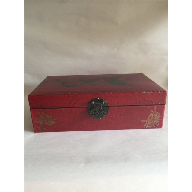Mid-Century large box with ornate brass accent closure, lotus motif and flying griffin or winged lucky dragon. Deep red...