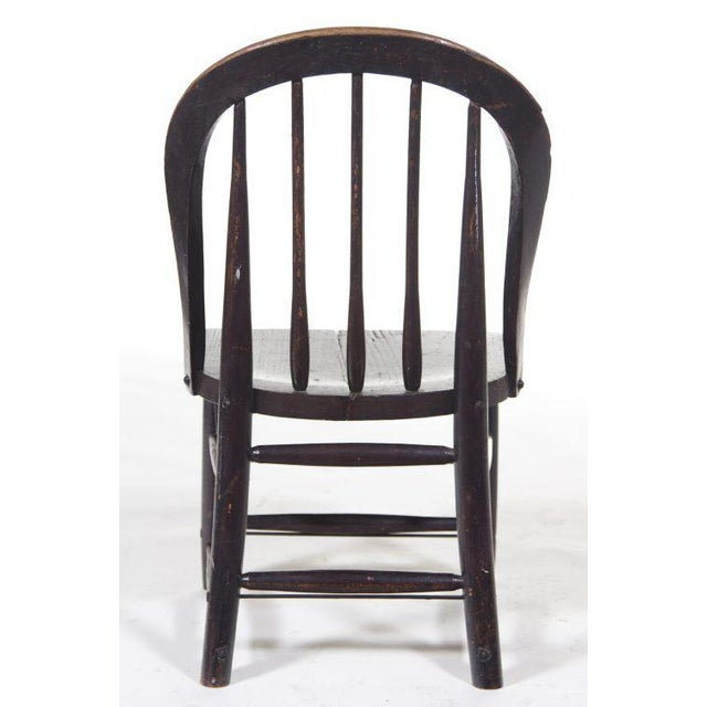A nice late variant of a Windsor chair probably made in England. Condition: Good with a nice old finish. Some one added...