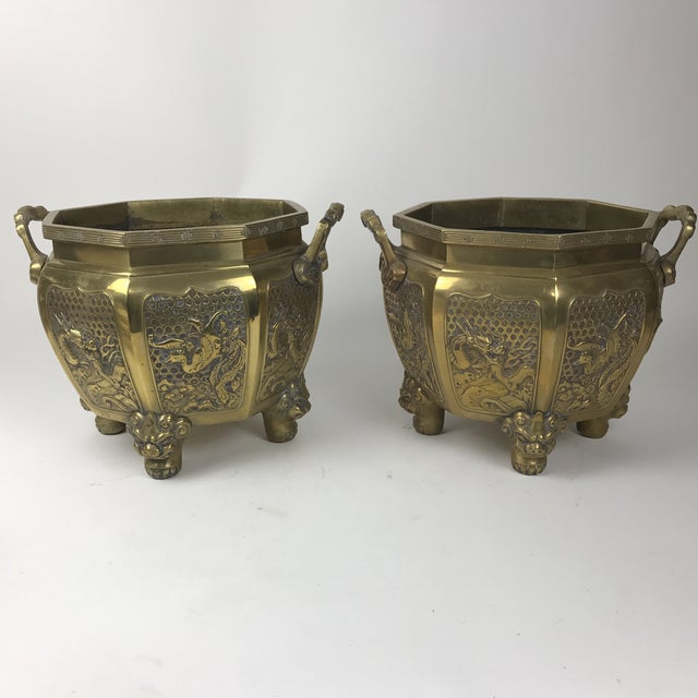 Gorgeous Heavy Japanese Brass Planters. They are octagon shaped with a medallion on each panel alternating dragons and...