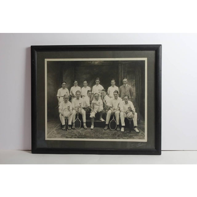 Antique photo of the junior tennis players framed in original wooden frame.