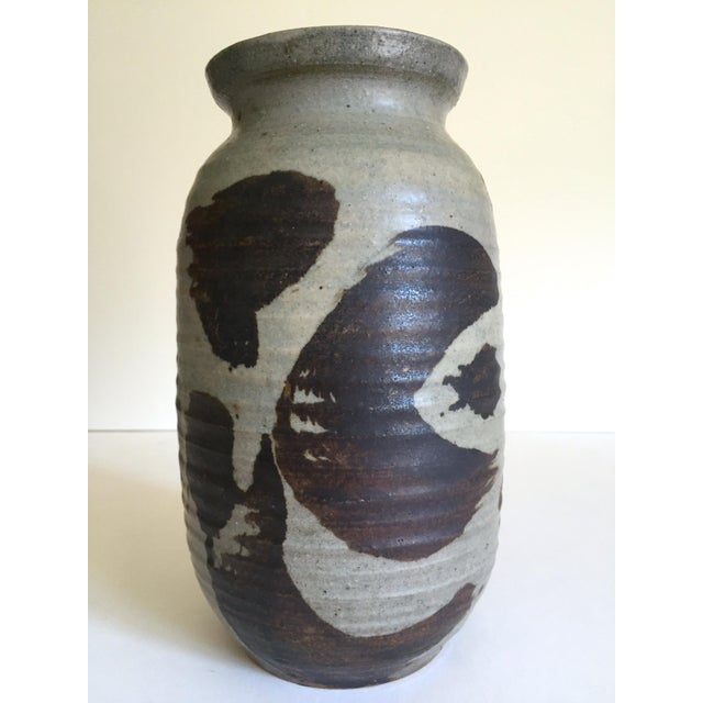 This vintage 1965 Mid Century Organic Modernist studio pottery Abstract Expressionist signed stoneware ceramic vase is a...