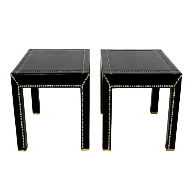 This is a fabulous pair of Italian mid-century modern rectangular accent tables. The pieces are entirely covered in fine...