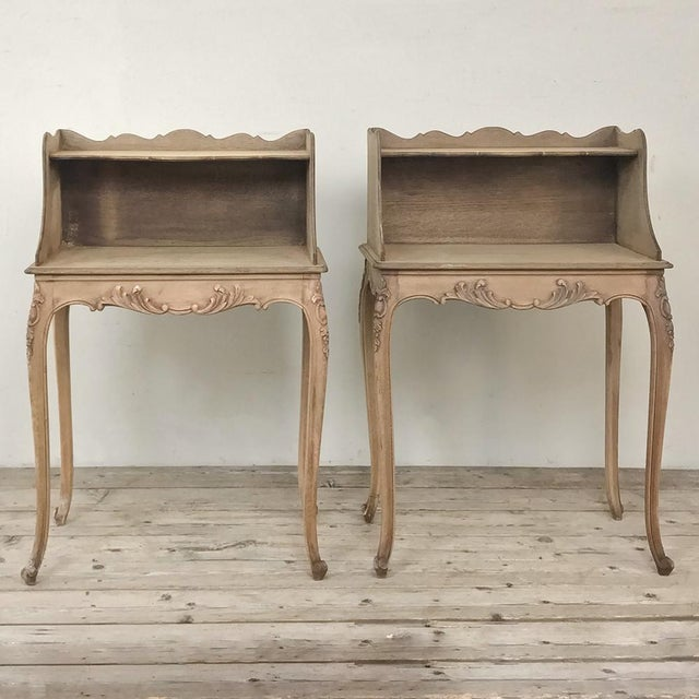 Pair Country French Provincial Nightstands were fashioned from solid oak and feature the undulating scrollwork of the...