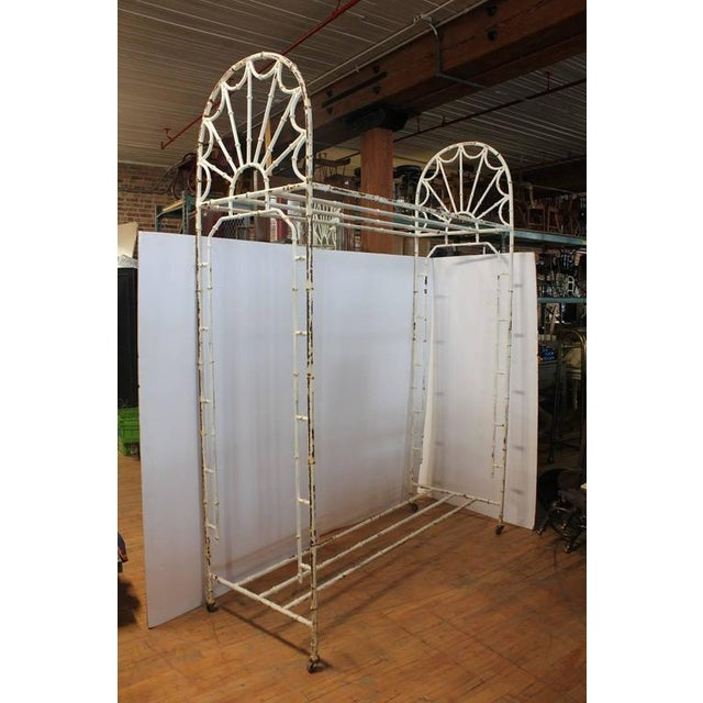 Antique American hotel coat and luggage rack.