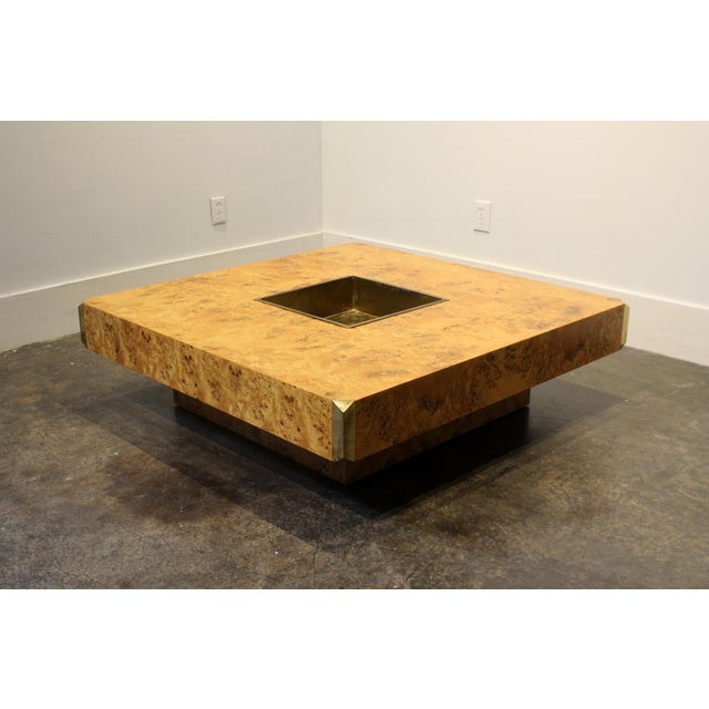 Gorgeous 1970's Italian coffee table by Willy Rizzo, made with light maple burl veneer, with striking brass accents on...