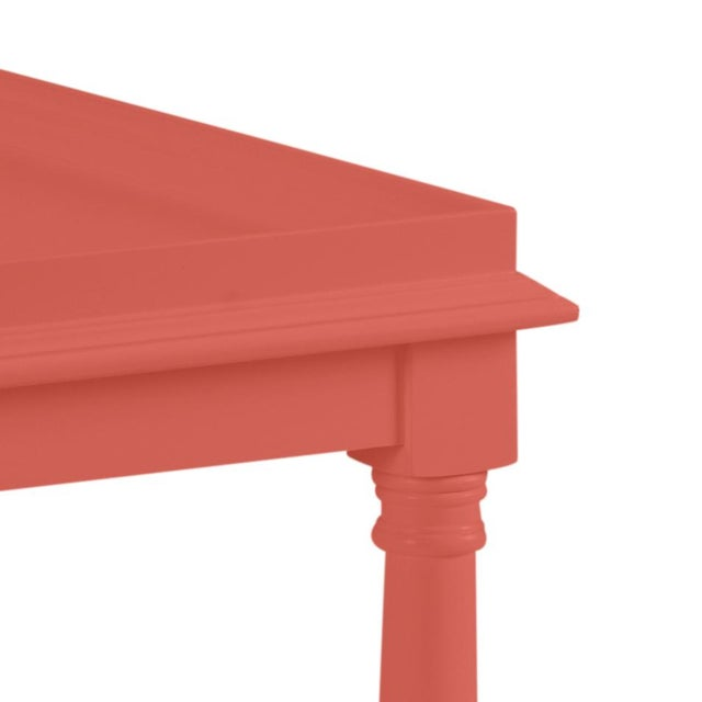 This acacia wood side table features a single shelf and turned legs. The color is Benjamin Moore Crimson with a semi-gloss...