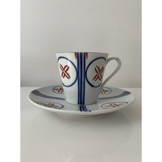 Elegant and simple mid century tea cups and saucers. Blue, white and maroon designs. Stripes that reach and extend from...