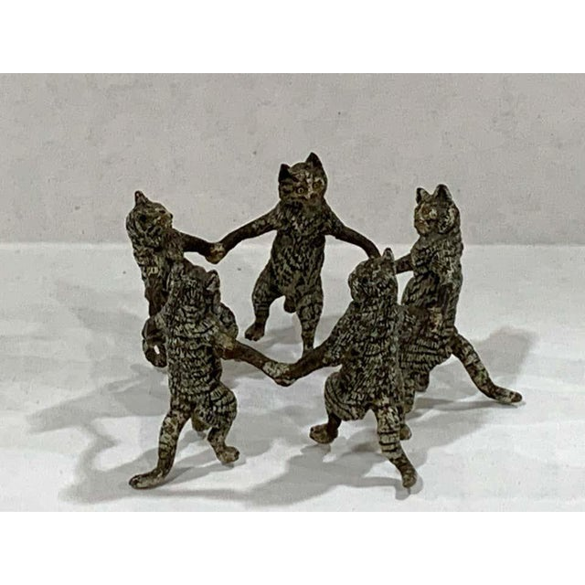 Vienna cold painted bronze dancing cats, attributed to Bergman Five standing cats realistically modeled and painted...