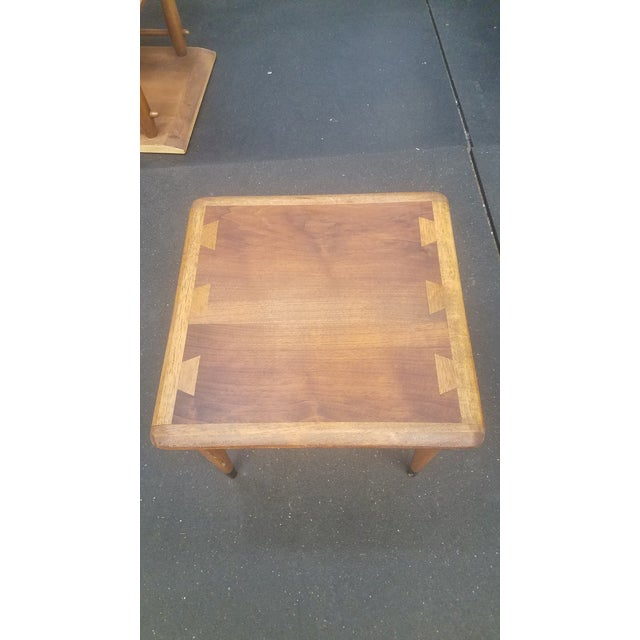 I sanded down the top to 1200, stained which honey colored stain and finished with coats of Danish oil. The top is very...