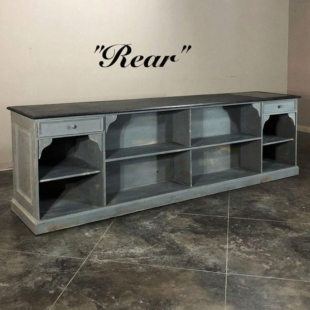 19th Century Painted Store Counter features a distressed painted finish, with a darker tone on the top for contrast....