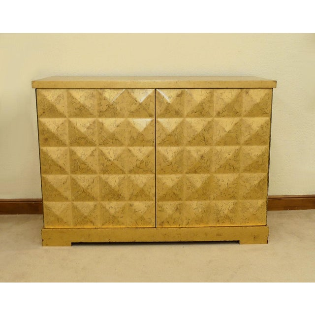 A nicely maintained gold leaf diamond cabinet or credenza designed by Barbara Barry for Baker Furniture. Features the...