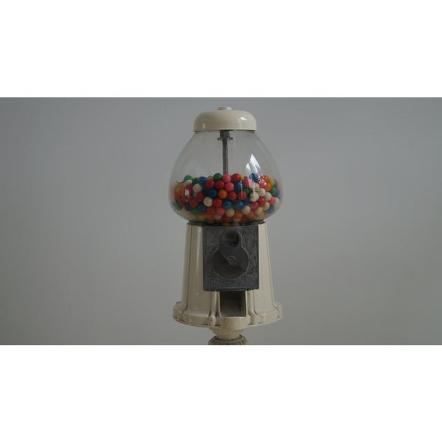 Charming metal gumball machine. A rare find, this a piece that has been pass down to all 3 generations since the 1920s. It...