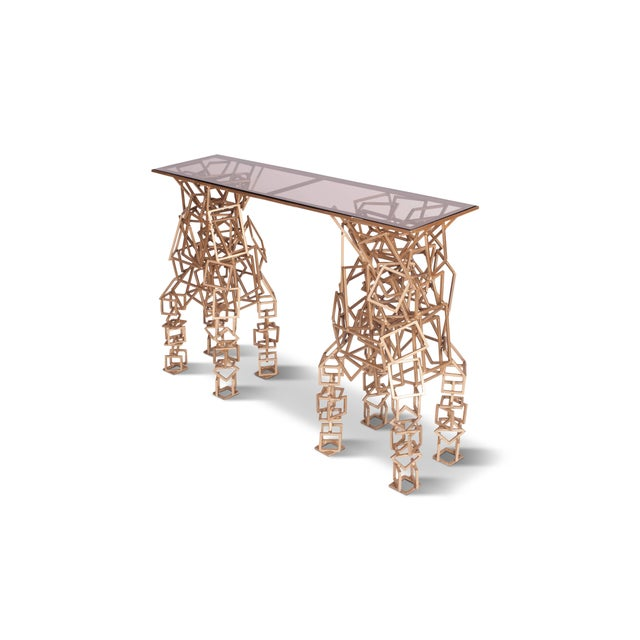 Handcrafted geometrically shaped console table consisting out of rectangles and squares in brass coloured gilded iron,...