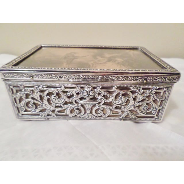 This is a Antique Baroque Ornate Sterling Silver Music Box that has a Wood Interior Overlayed with Thick Sterling Silver...