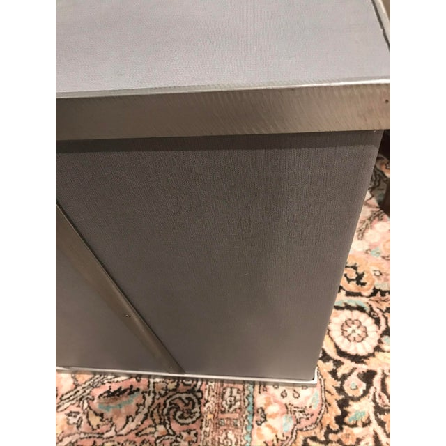 Kravet Rubell cube table in grey. Fully wrapped in a grey leather with a pewter metal frame. Very heavy, about 65 lbs....