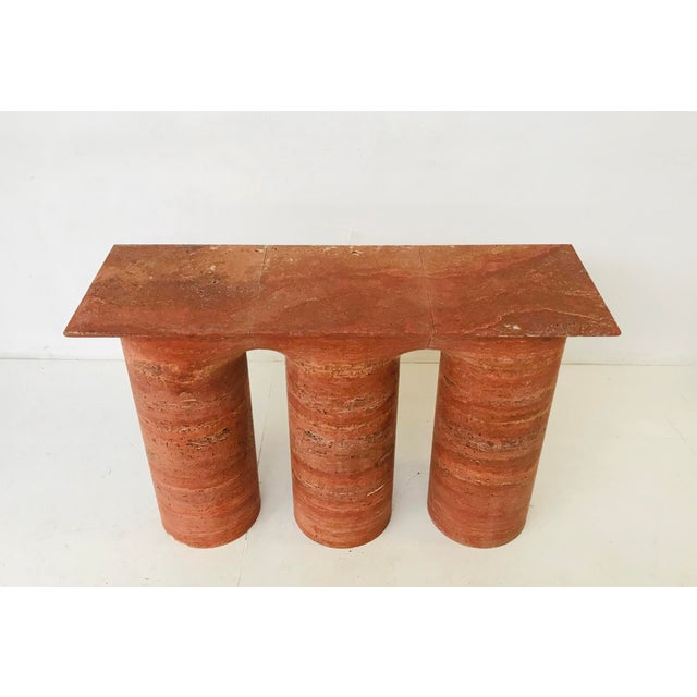 Italian red travertine console. This piece would look great in a modern home.