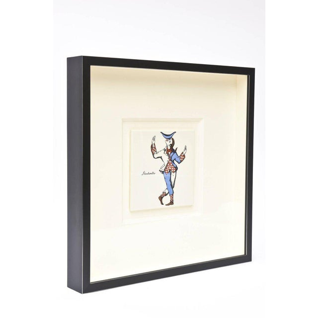 These amazing pair of vintage Mid-Century Modern authentic Piero Fornasetti hallmarked harlequin jester plaques are very...