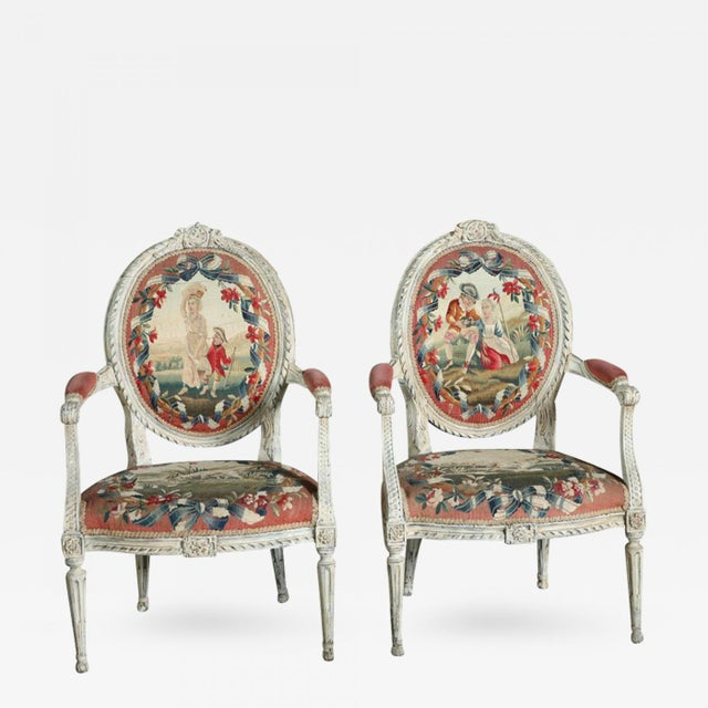 The oversize frame carved with central crest and overall beading, foliate, guilloche and berry motif, upholstered in fine...